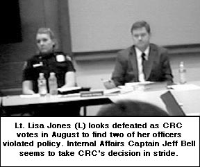 Lt Lisa Jones (L) looks defeated as CRC votes in August  to find two  of her officers violated policy. Internal Affairs Captain Jeff Bell seems to take CRC's decision in  stride.